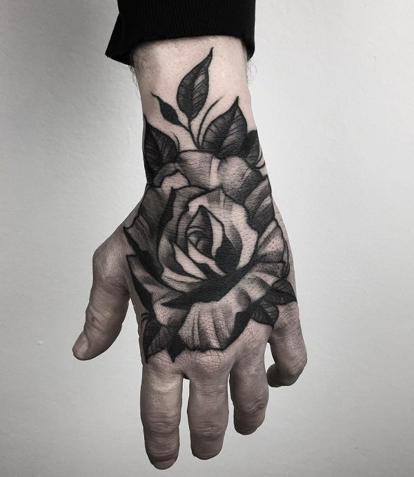 Dante's rose-hand-tattoo from the book Caraval